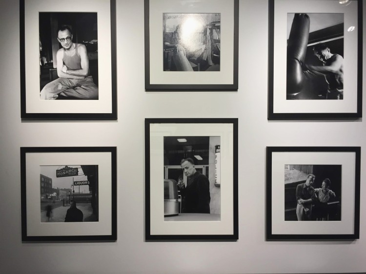black and white photos framed on a wall