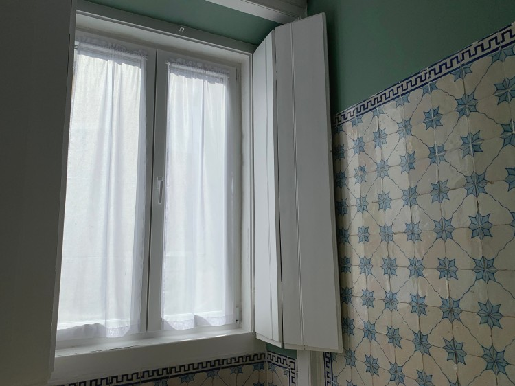 large window on a tiled wall
