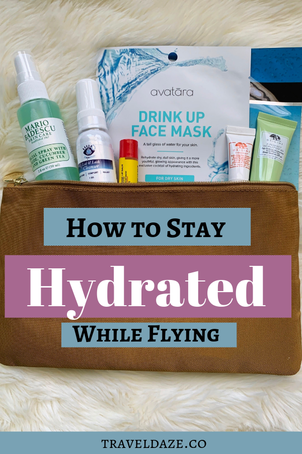 Bag filled with skincare products. Text overlay reads: How to Stay Hydrated While Flying