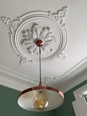 bronze light hanging from ceiling