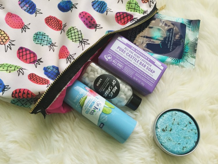 beauty products coming out of a makeup bag