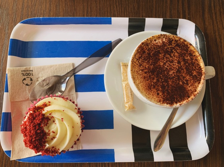 overhead view of a coffee and cupcake