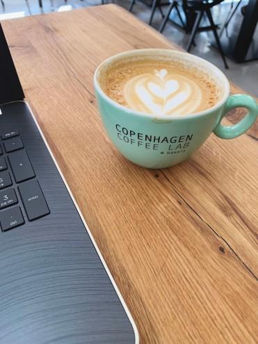 latte next to a laptop