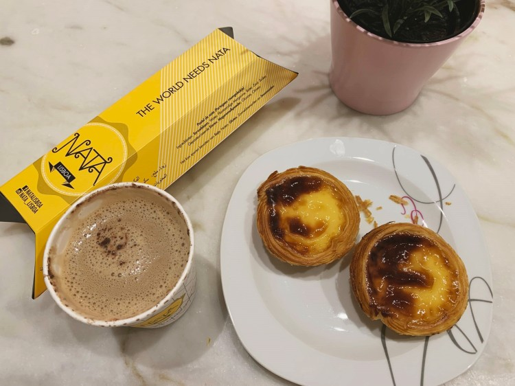 Pastel de Nata on a plate with a coffee