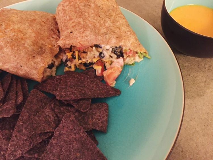veggie burrito and tortilla chips on a blue plate