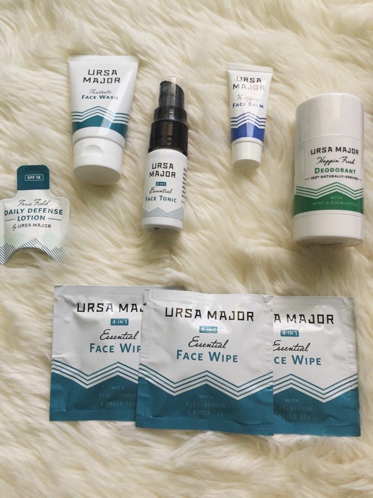 travel size skin care products arranged on a white background