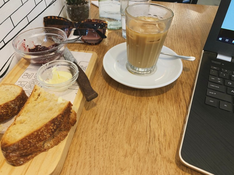 cafe breakfast and laptop on a table