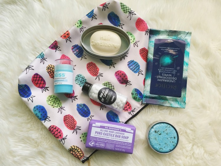 beauty products with a pineapple makeup bag