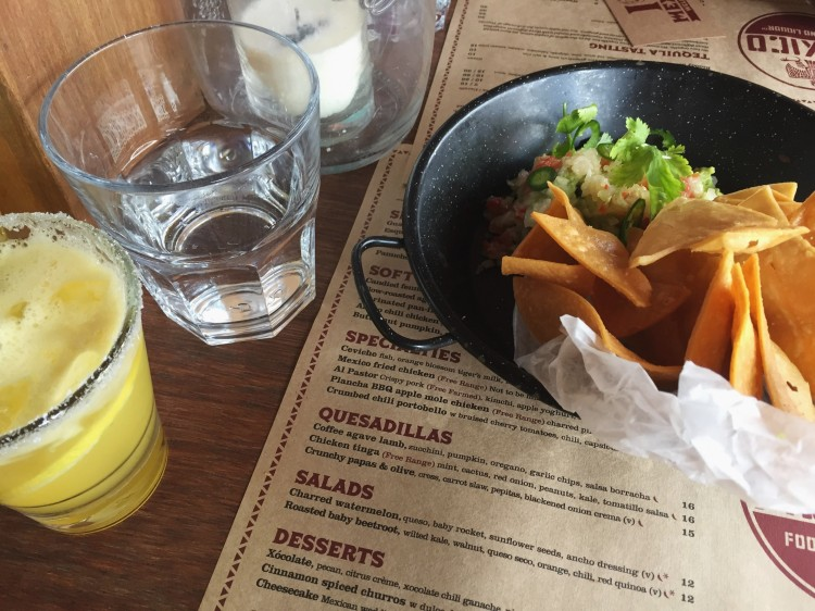 margaritas and a bowl of chips on a restaurant table
