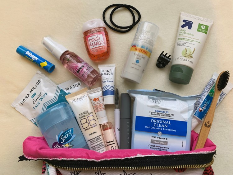 flat lay of beauty products arranged in a makeup bag